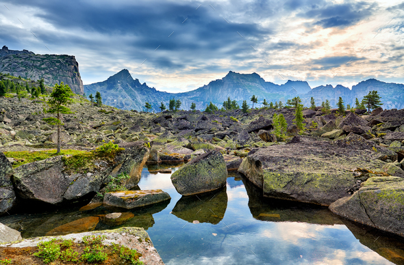 Small Lake among Glacial Moraines in High Mountainous Terrain - Stock Photo - Images