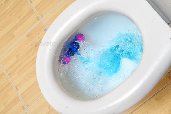 Toilet bowl flushing - Stock Photo - Images