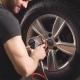 Car Mechanic Changing Car Wheel in Auto Repair Garage. - VideoHive Item for Sale