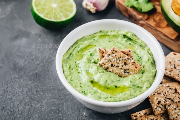 Avocado dip with cilantro and lime - Stock Photo - Images