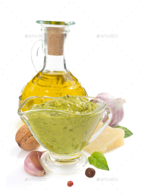 pesto sauce in gravy boat on white - Stock Photo - Images