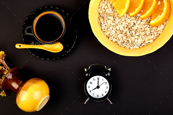 Morning coffee, granola breakfast, alarm clock - Stock Photo - Images