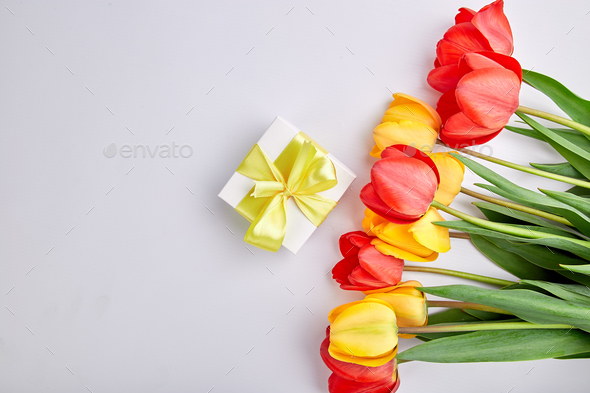 White gift box with yellow ribbon - Stock Photo - Images