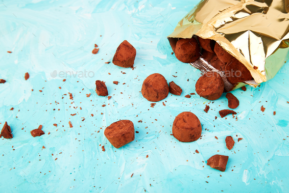 Chocolate Candy truffles fall out - Stock Photo - Images