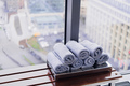 Stack of rolled towels in hotel at gym with city view - PhotoDune Item for Sale