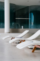 Modern deck chairs at luxury hotel. Private swimming pool for relaxation, with beautiful interior. - PhotoDune Item for Sale