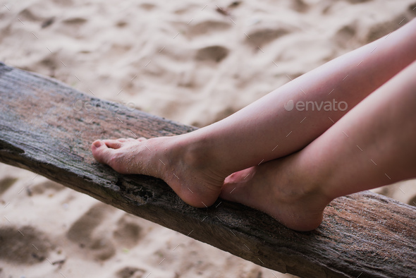 woman hands and legs close up on a piece of wood outdoors - Stock Photo - Images