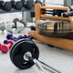 Weight plates and dumbbells on floor in gym, close up - PhotoDune Item for Sale