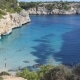 Beach and Turquoise Water Near the Stone Coast, Spain - VideoHive Item for Sale