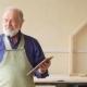 Old Craftsman in Working Uniform Holding Digital Tablet in the Workshop. - VideoHive Item for Sale