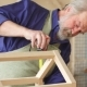 Old Grey Haired Carpenter with Moustache and Beard Measuring Wooden Doll House. - VideoHive Item for Sale