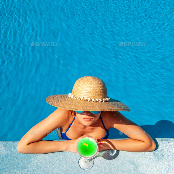 Woman at poolside with cocktail - Stock Photo - Images