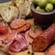 Sliced Prosciutto and Salami Sausage on a Wooden Board - VideoHive Item for Sale