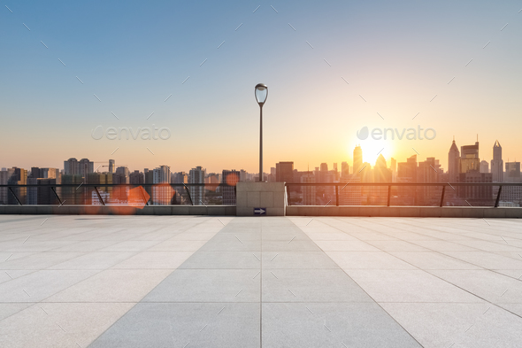 empty floor in sunset with skyline and buildings - Stock Photo - Images