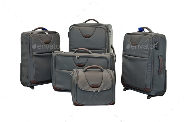 Travel luggage set with airplane in background - Stock Photo - Images