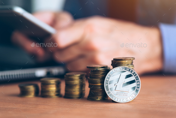 Litecoin cryptocurrency trader - Stock Photo - Images