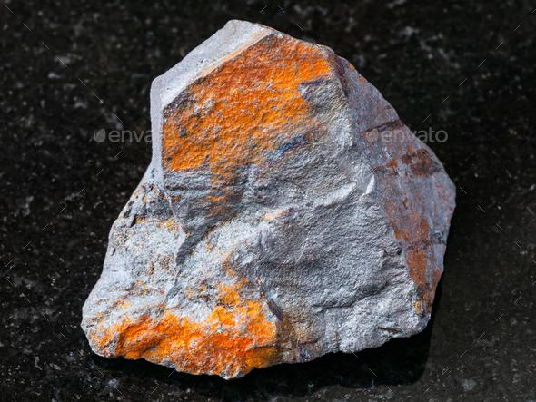 raw Hematite ore on black granite - Stock Photo - Images