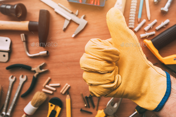 Maintenance handyman gesturing thumb up approval hand sign, top - Stock Photo - Images