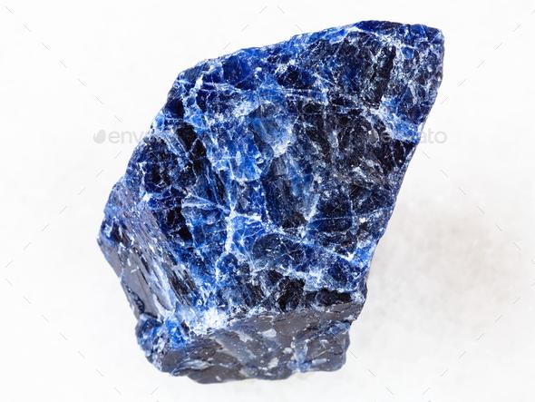rough Sodalite gemstone on white - Stock Photo - Images