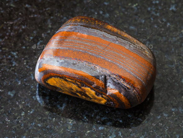 Jaspillite (Taconite Jasper) gemstone on black - Stock Photo - Images