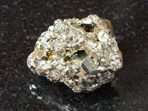rough iron pyrite stone on black - Stock Photo - Images