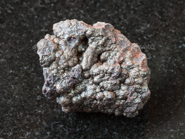Goethite stone (brown iron) on black - Stock Photo - Images