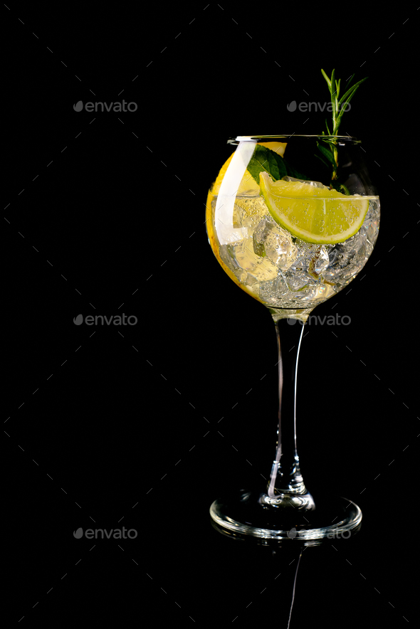 Glass of a cold cocktail drink with white wine - Stock Photo - Images