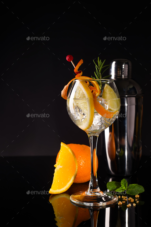Glass of a cold cocktail drink with white wine served with brown sugar, orange and shaker - Stock Photo - Images