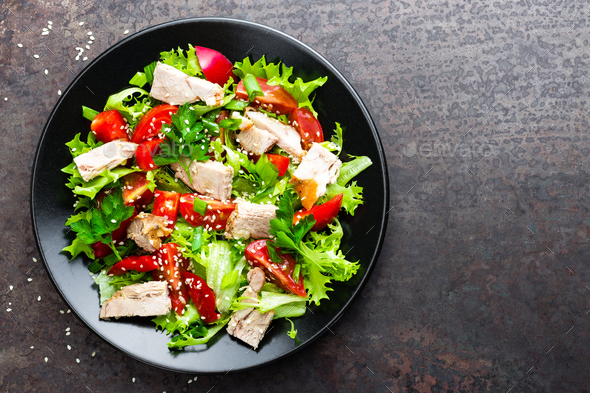 Salad with meat. Fresh vegetable salad with baked meat. Meat salad with fresh vegetables on plate - Stock Photo - Images