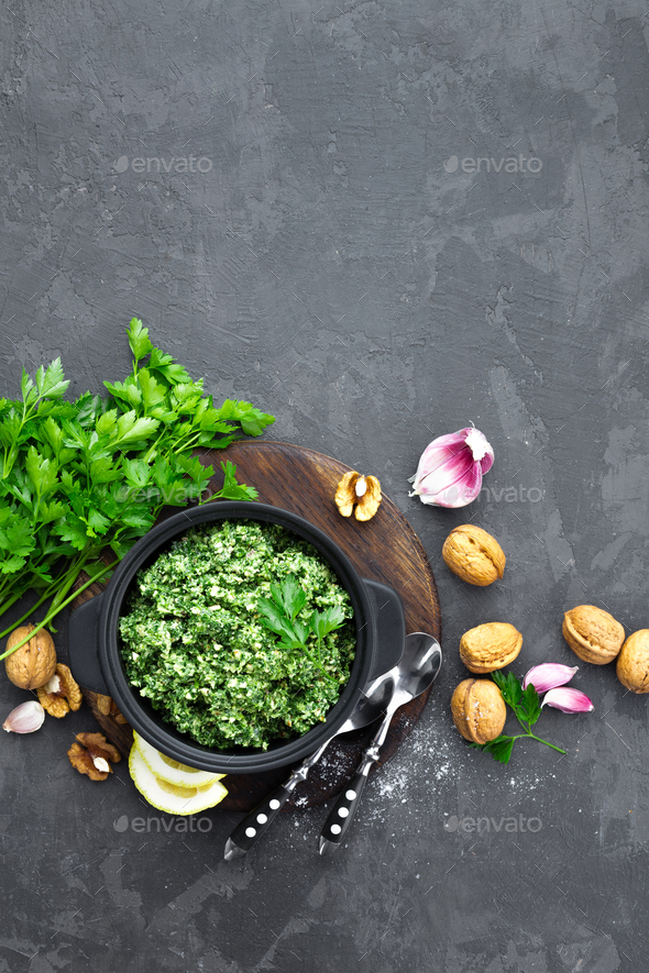 Pesto. Italian pesto with fresh pasrley, garlic, lemon juice, walnuts and olive oil - Stock Photo - Images