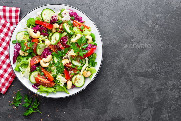 Vegetable salad. Fresh salad with vegetables and nuts - Stock Photo - Images