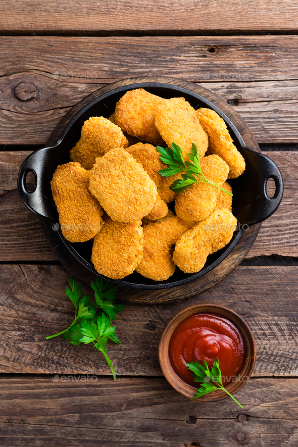 Nuggets. Chicken nuggets with ketchup on wooden table. Fast food - Stock Photo - Images