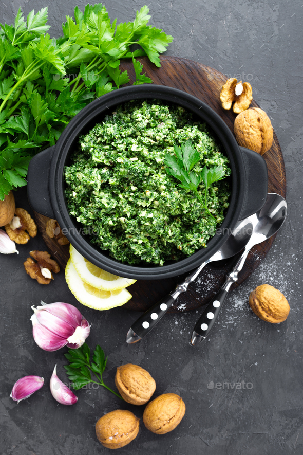 Pesto. Italian pesto with fresh pasrley, garlic, lemon juice, walnuts and olive oil - Stock Photo - Images