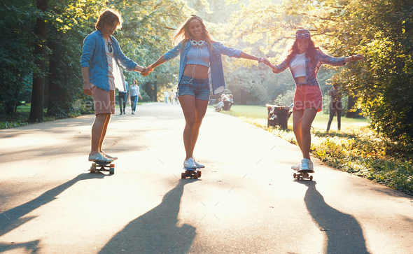 Young active skaters outdoors - Stock Photo - Images