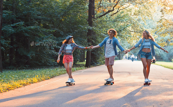 Young happy skaters on vacation - Stock Photo - Images