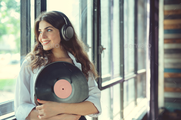 Young woman listen to music on headphones - Stock Photo - Images
