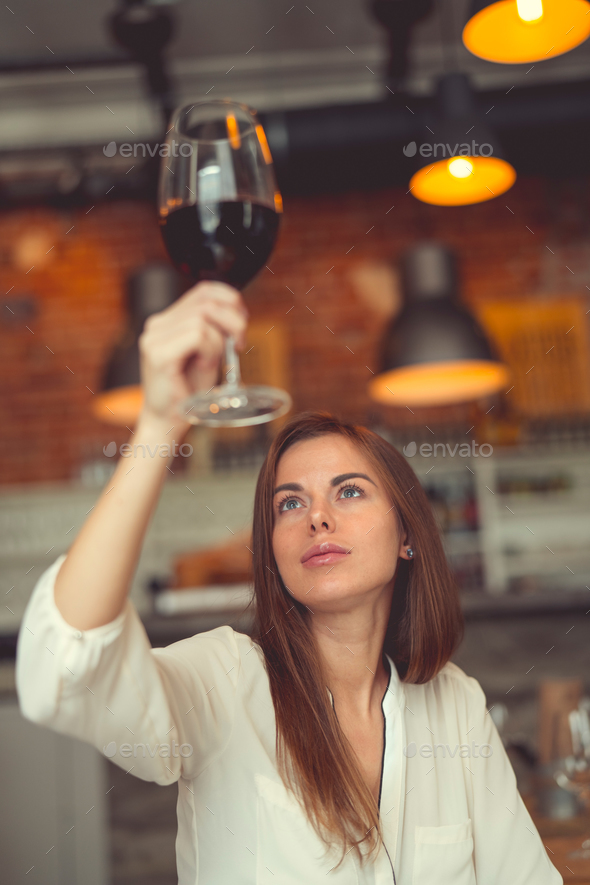 Young woman with a glass of wine - Stock Photo - Images