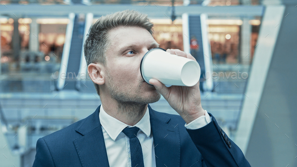 Young businessman drinking coffee - Stock Photo - Images