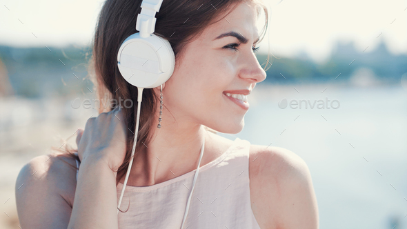 Smiling girl listen to music - Stock Photo - Images