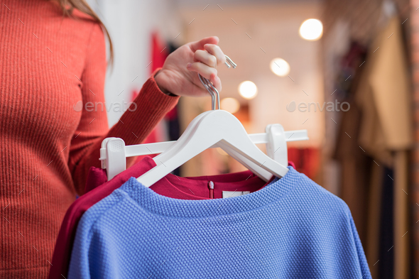Young girl with clothes close-up - Stock Photo - Images