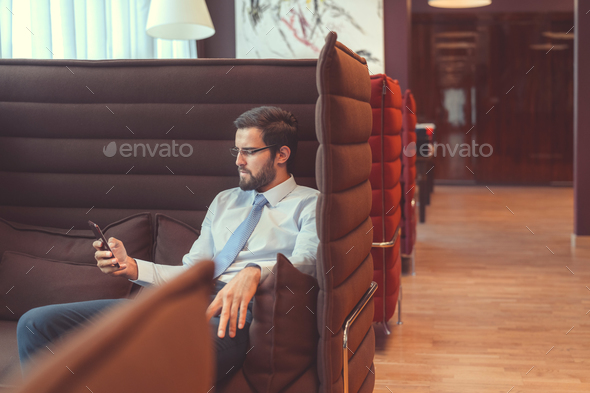 Young businessman with a phone - Stock Photo - Images