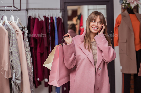 Young girl with shopping bags - Stock Photo - Images