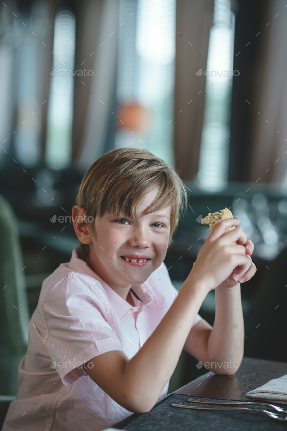 Little boy with a piece of cake - Stock Photo - Images