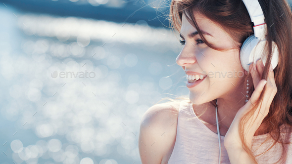 Smiling woman listen to music - Stock Photo - Images