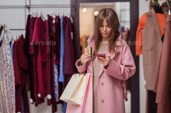Young girl with a credit card - Stock Photo - Images