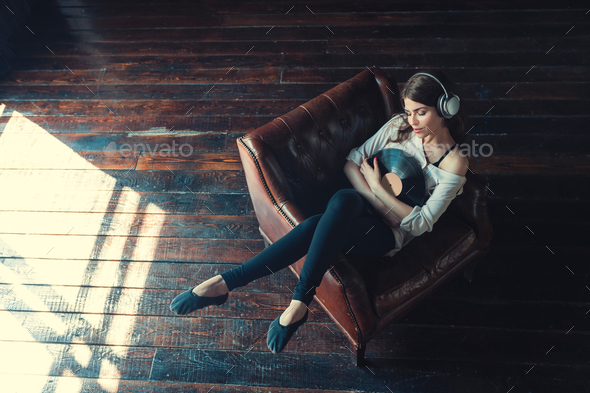Young woman listen to music indoors - Stock Photo - Images