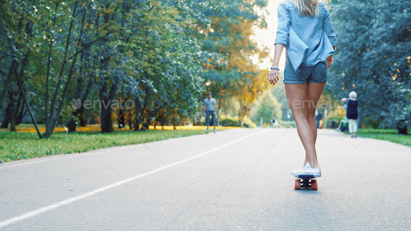 Young girl skating in the park - Stock Photo - Images