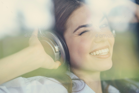 Pretty young girl listen to music - Stock Photo - Images