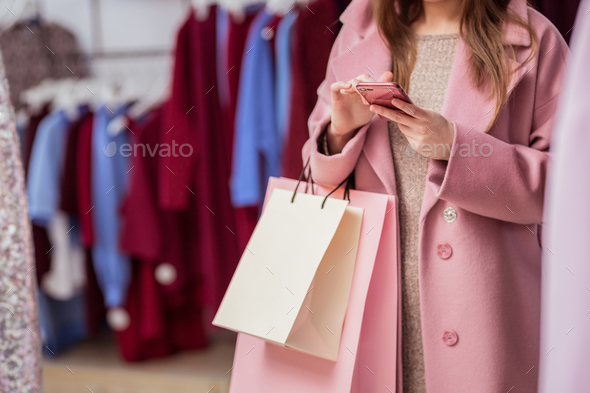 Young girl with shopping bags indoors - Stock Photo - Images