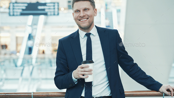 Young smiling businessman with coffee - Stock Photo - Images